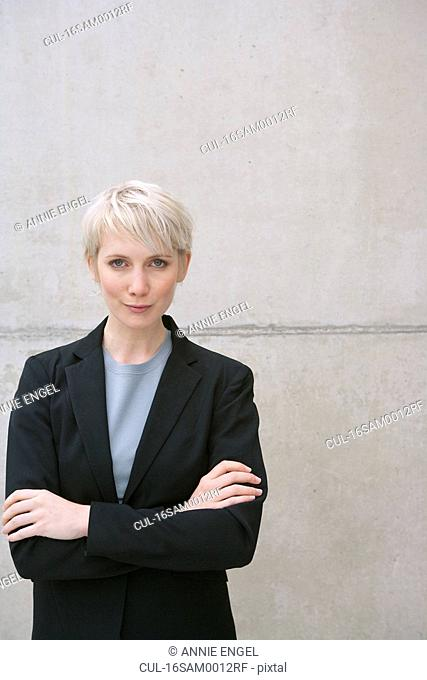 woman in suit arms crossed