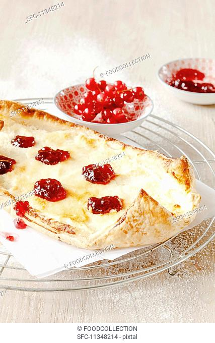 A quark pastry boat with redcurrant jelly