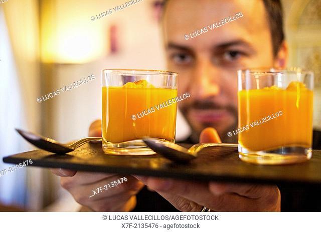 waiter shows a pumpkin cream. La Embajada restaurant,7 Alfonso el Magnánimo. Valencia. Spain