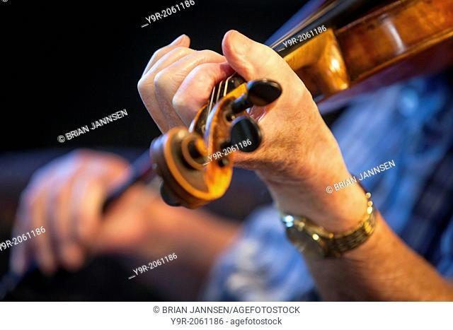 Closeup of man playing violin