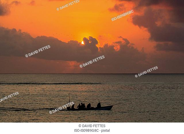 Seascape with silhouetted fishing boat at sunset, Zanzibar,Tanzania, Africa