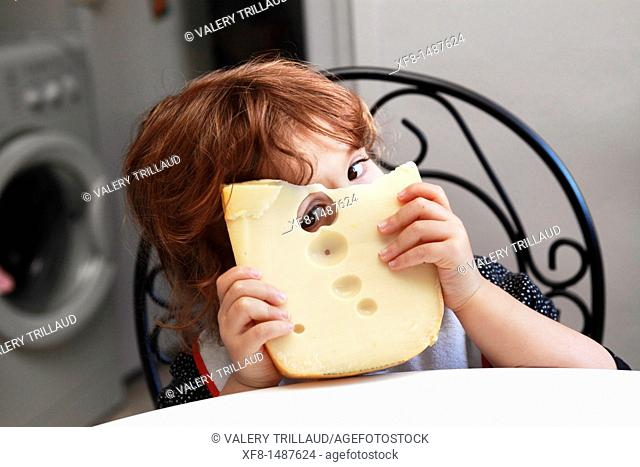 Faustine, 36 months old eating cheese with hole