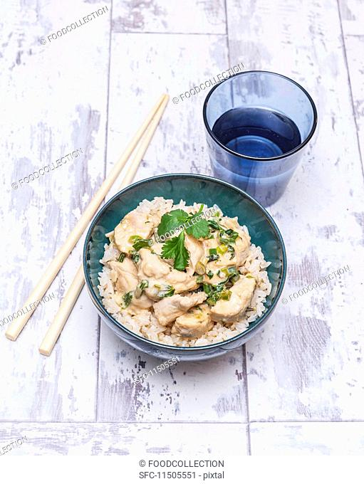 Chicken in coconut milk on a bed of rice