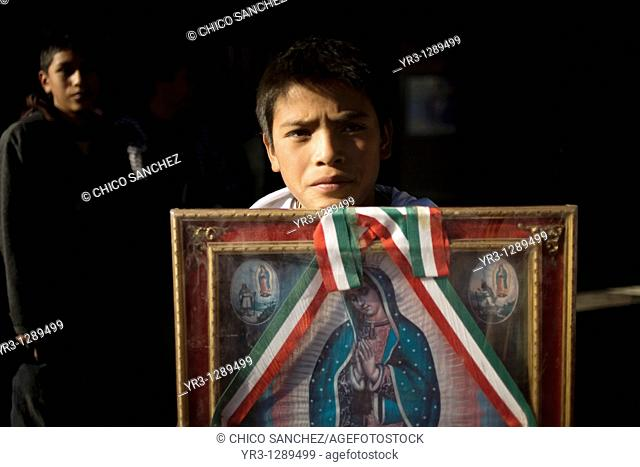 A young pilgrim carries an image of the Our Lady of Guadalupe outside of the Our Lady of Guadalupe Basilica in Mexico City, December 10