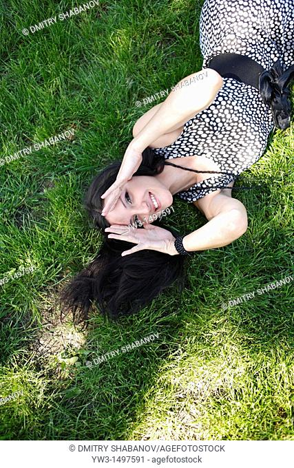 25 year old woman outdoors on the grass