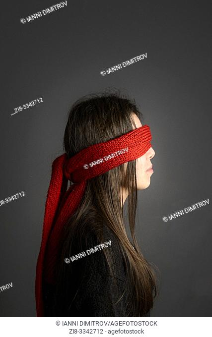Young girl with long dark hair blindfolded with red scarf- sode vie