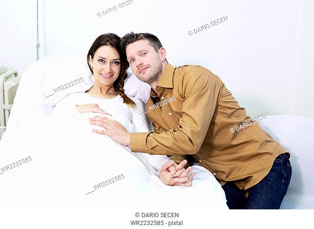 Portrait of female patient and boyfriend in hospital