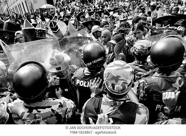Indians clash with the riot police block during the Inti Raymi San Juan festivities in Cotacachi, Ecuador, 29 June 2010  'La toma de la Plaza' Taking of the...