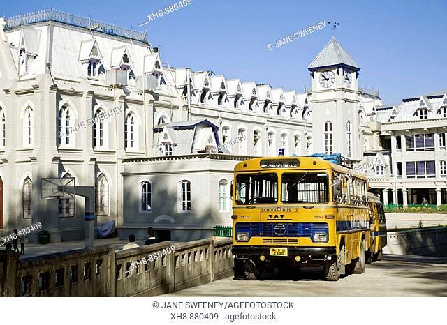 India, West Bengal, Darjeeling, Yellow school bus infront of St Joseph Christian school