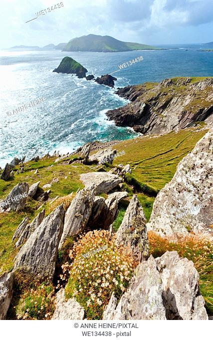 looking from dingle peninsula in western ireland towards blasket islands while sky is clearing, coordinates: 52.109576, -10.477570,exposures enfused