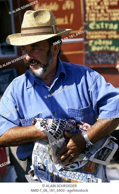Close-up of a mature man holding a newspaper, Bermondsey Market, London, England