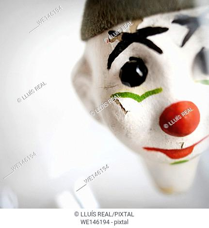 Close-up of a face of a clown puppet