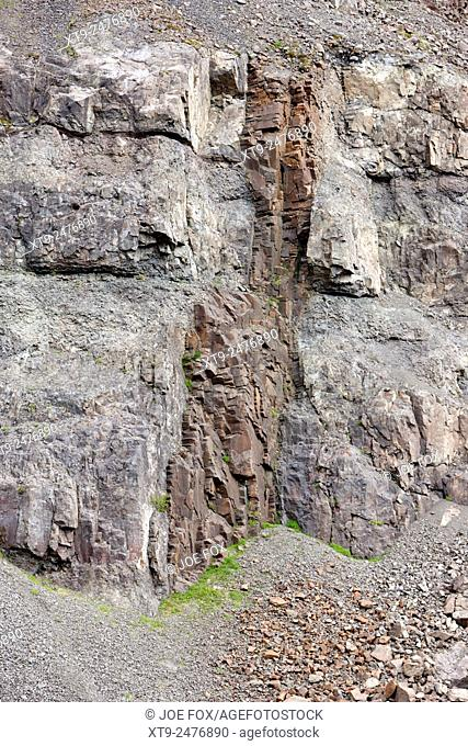 basalt dyke rock formations formed by magma hardening in rock fractures in the hillside Iceland