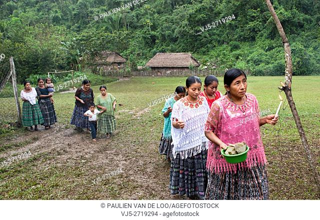 Chahal, Alta Verapaz, Guatemala, women bring offers for the ceremony to pray for a good harvest