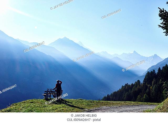 Mountain biker in mountains, Valais, Switzerland