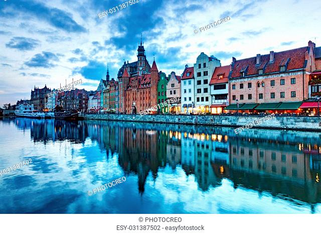 View of Gdansk old town and Motlawa river, Poland at romantic sunset. The city also known as Danzig and the city of amber