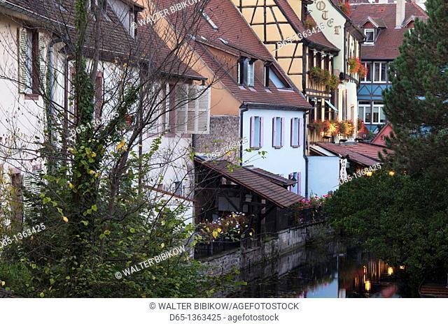France, Haut-Rhin, Alsace Region, Alasatian Wine Route, Colmar, Petite Venise area by Lauch River, evening