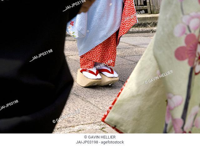 Maiko women wearing Kimonos & Okobo (tall wooden shoes), Gion district, Kyoto, Japan