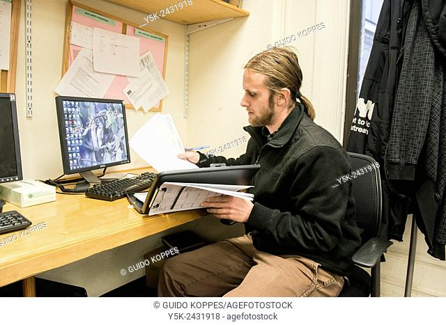 New York, USA, Male social worker with Goddard Riverside, preparing for his outreach to homeless persons, living in the streets of Manhattan