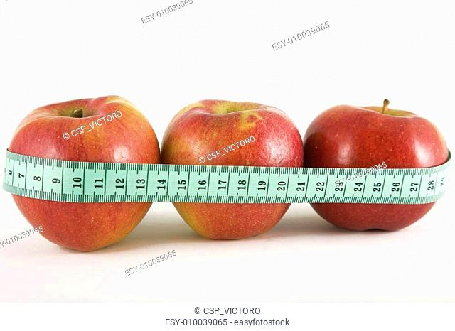 three red apple and green measurement tape