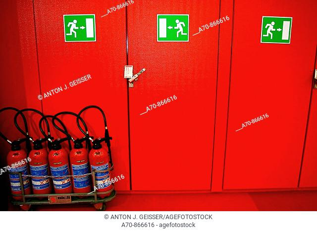 Emergency exit fire extinguisher