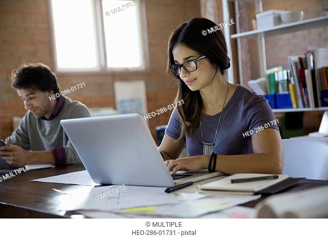Designer using laptop in office
