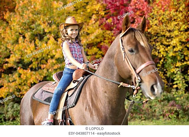 A Beautiful and natural adult woman outdoors with horse