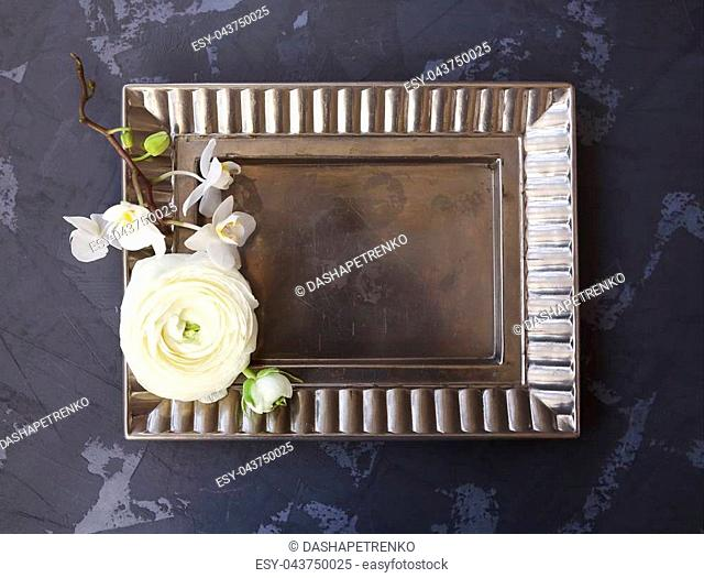Festive invitation card with beautiful flowers and tray on the dark background