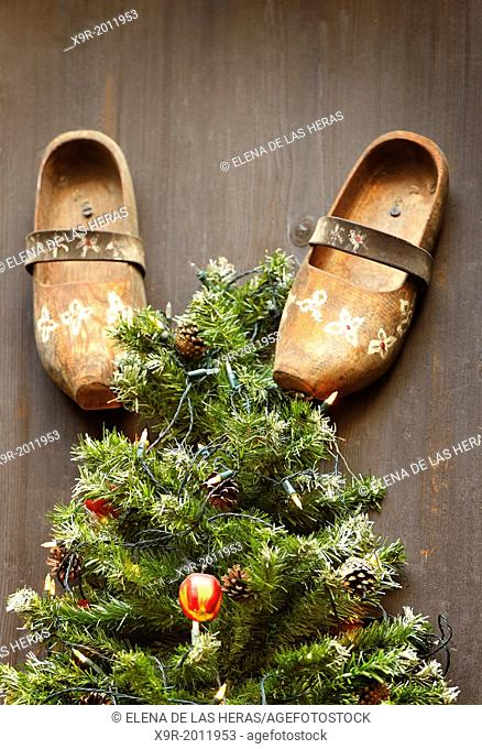 Traditional wooden shoes and fir tree Christmas decoration. Colmar. Haut-Rhin. Alsace. France