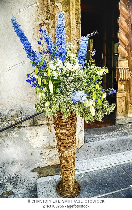Flowers at the entrance into the church of Andrew the Apostle (Heiliger Andreas) in Kitzbuhl, Austria