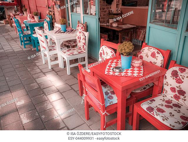 Retro, vintage view of Pastel coffee shop with wooden tables and chairs in Balat, old town of Istanbul, Turkey. Outdoor cafe