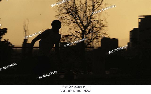 WS PAN Silhouette of man playing basketball / Salt Lake City, Utah, USA