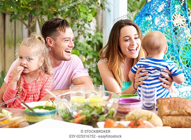 Family Enjoying Outdoor Meal At Home