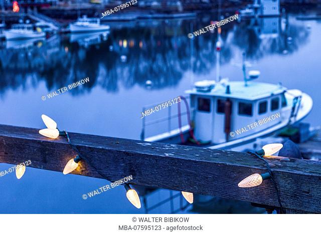 USA, New England, Cape Ann, Massachusetts, Annisquam, Lobster Cove, lobster boat and Christmas Lights