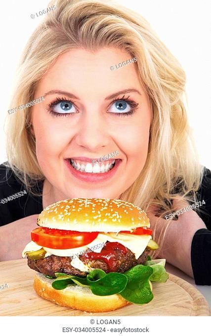 pretty woman finds hamburger and looks forward