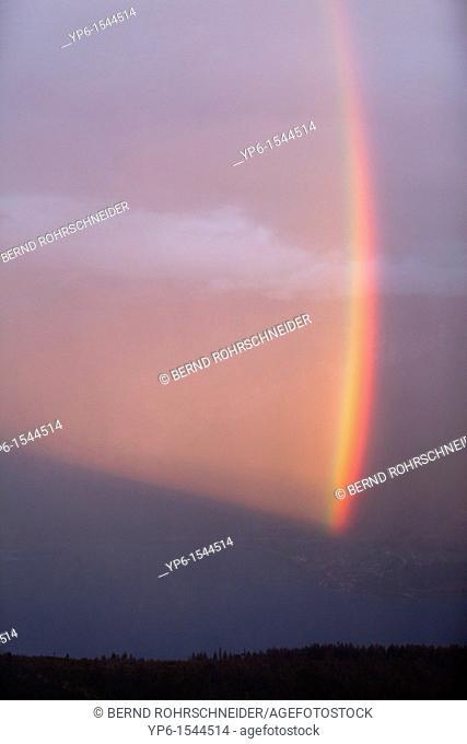 rainbow over Lake Thun while sunset, Bernese Oberland, Switzerland