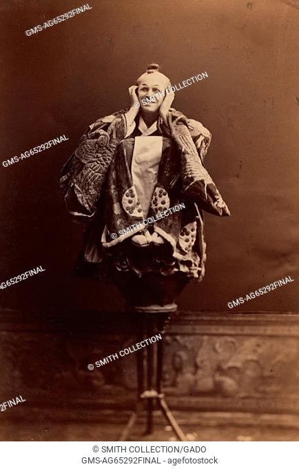 A full length portrait of George Thorne in character as Ko-Ko, from the Gilbert and Sullivan Opera The Mikado, as staged by the D'Oyly Carte Opera Company