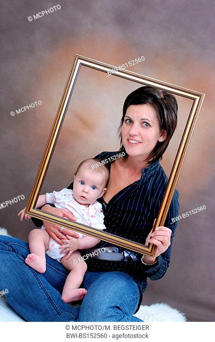 mother with six month old baby in a frame