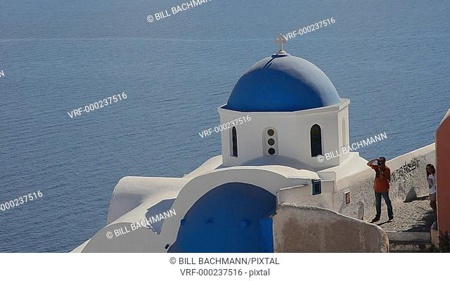 Greece Santorini Oia Cyclades blue church dome and steep mountains Greek Islands beautiful peaceful place