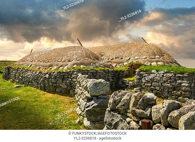 Picture & image of the exterior with stone walls and thatched roof of The historic Blackhouse, 24 Arnol, Bragar, Isle of Lewis, Scotland