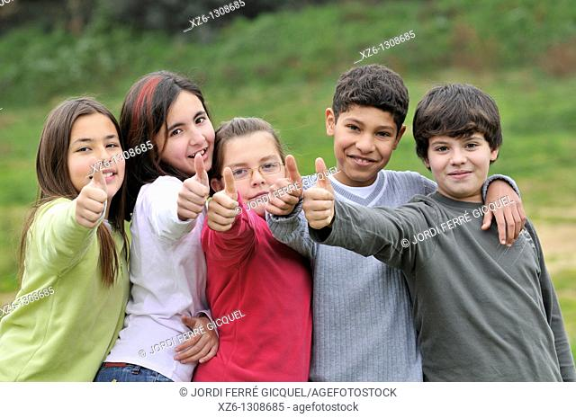Group of children, thumbs up. Spain