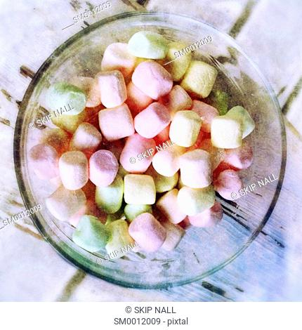 A bowl of different colored marshmallows