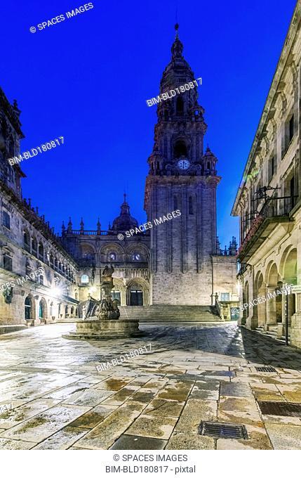 Ornate church and tower with fountain, Santiago de Compostela, A Coruna, Spain