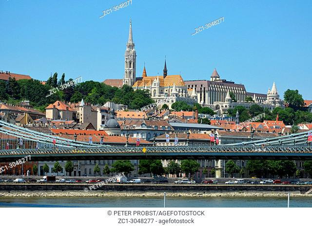 View of the Chain bridge over the Danube river to the historic buildings in the Buda disdrict with Matyas church and Fishermen's Bastion in Budapest - Hungary