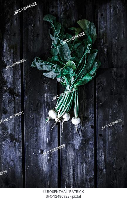 White radishes on a wooden surface