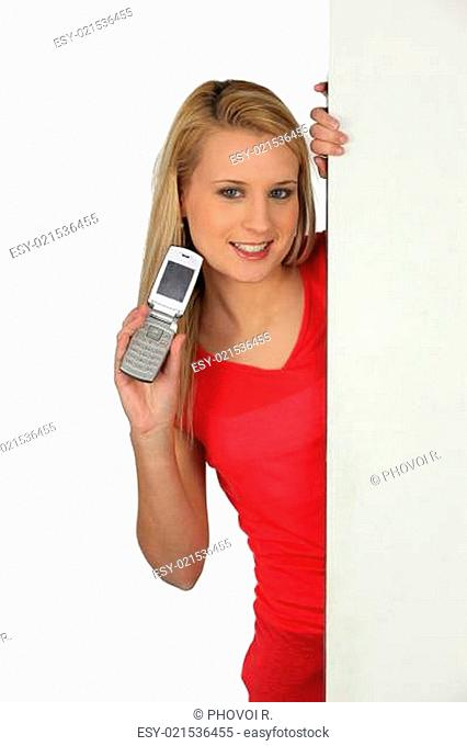 Young woman with an open cellphone and board left blank for your message