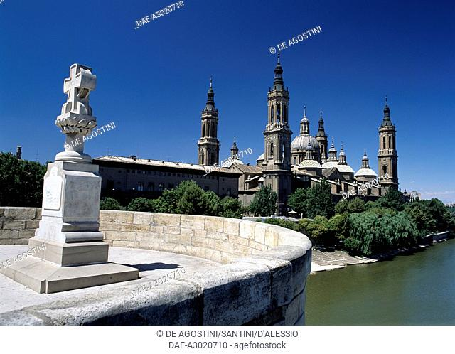 Basilica of Our Lady of the Pillar, 1681-1872, viewed from the stone bridge in Zaragoza, Aragon. Spain, 17th-19th century