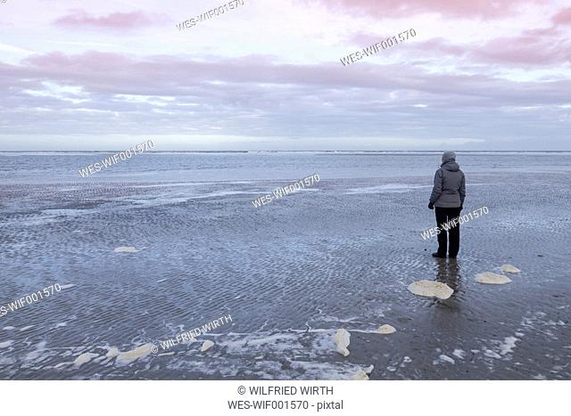 Germany, Langeoog Island, woman at the coast