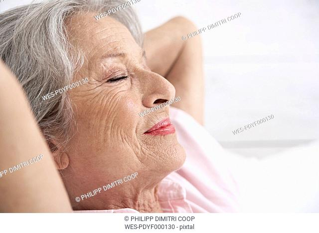 Spain, Senior woman relaxing, smiling