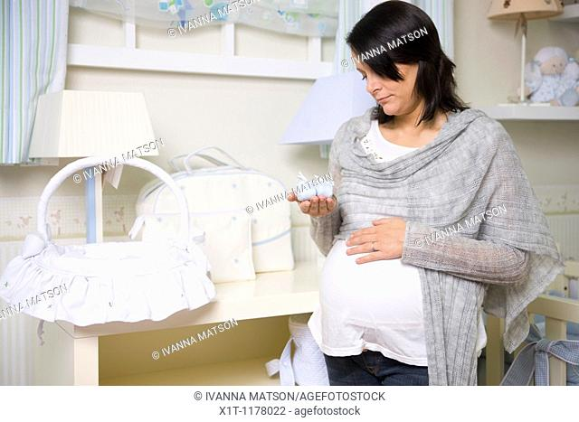 Pregnant women in the baby's room